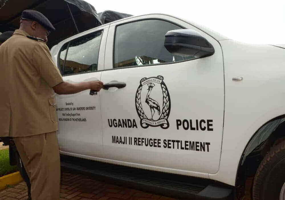 IGP Okoth Ochola opens a car donated by RLP through Embassy of the Netherlands in Uganda